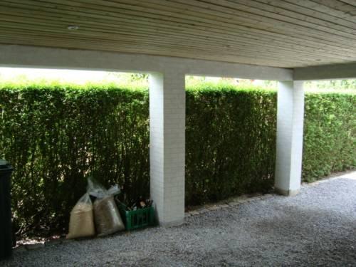Carport med loft og murede søjler