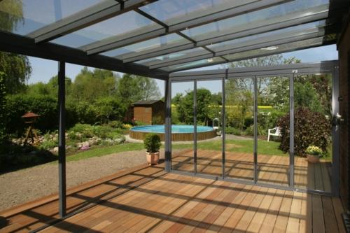 Solarlux Atrium Plus Udestue anlagt i flot have med pool